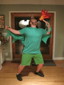 guy in dragon costume has fire on a stick