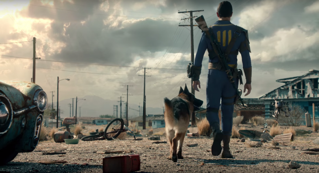 a man walks with his dog in a post apocalyptic landscape